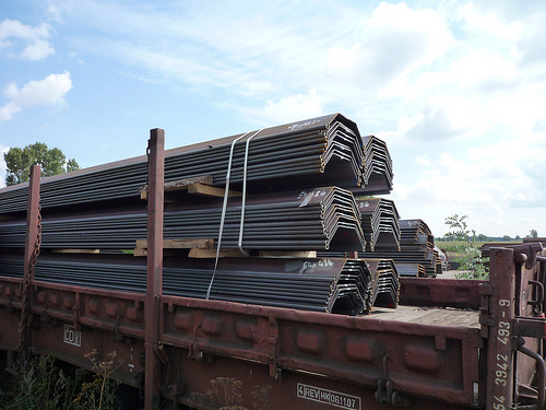 Delivery of virgin material from the rolling mill by train, pile sheets and U-profiles