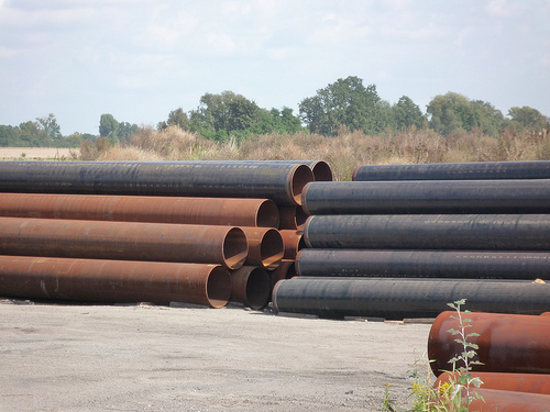 Pipe depot, large steel pipes, virgin material, IIA material